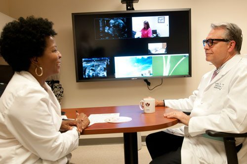 Roz Perkins, APN, and Curtis Lowery, MD, conducting a high risk OB clinic. Telehealth Best Practices