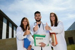group of young happy medical students on hospital university campus
